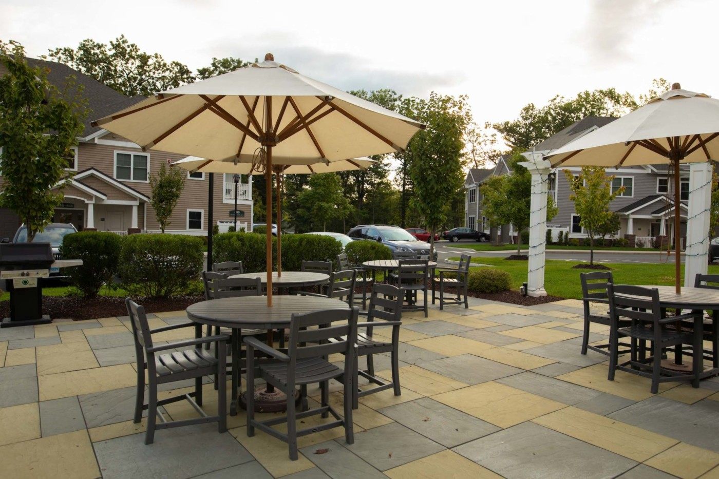 Patio with tables and chairs under umbrellas